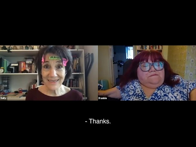 A still from the play which shows a video call between two people: Sally on the left and Frankie on the right. Sally has three post-it notes stuck to her face and a naive, even foolish, smile on her face. Frankie is disgruntled and sighing at Sally.
