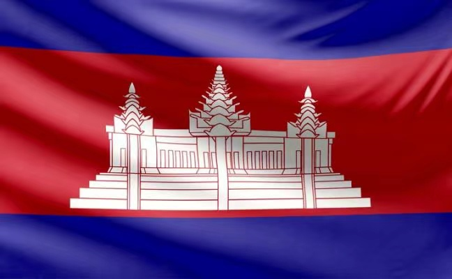 The Cambodian flag. A blue background with a red horizontal strip, and a white temple in the centre.
