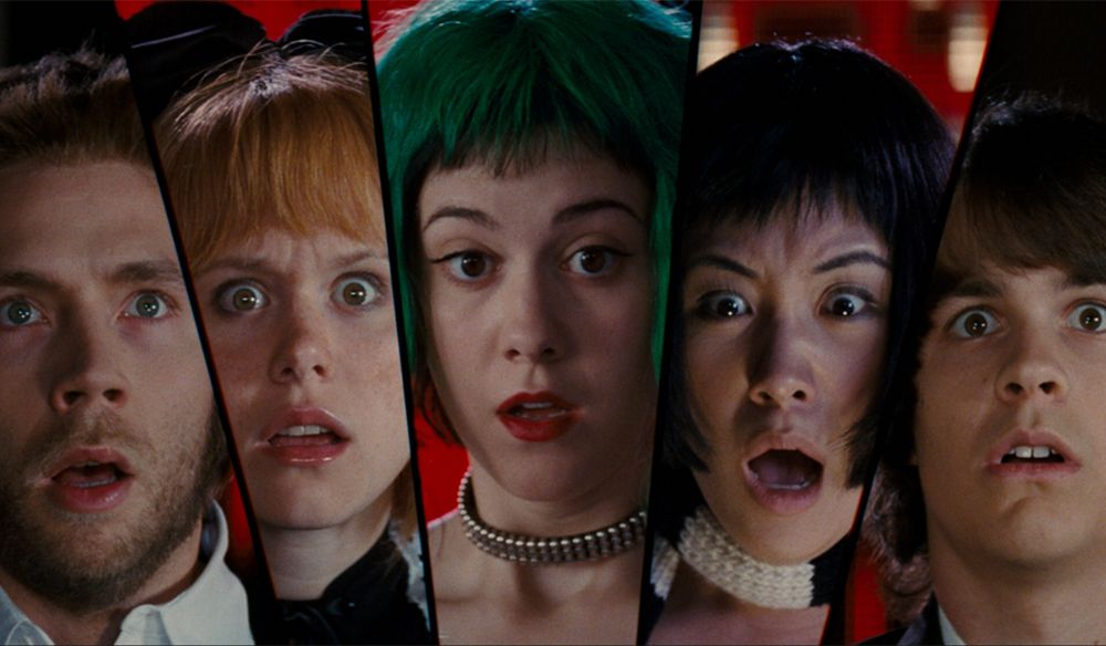 A selection of 5 Scott Pilgrim vs The World characters' faces are arranged in a comic-book style screen splice, all facing forwards with wide eyes and open mouths, looking shocked and horrified
