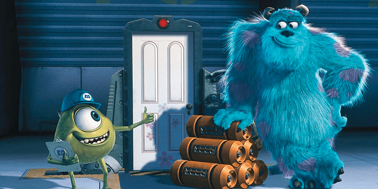 A still from Monsters Inc. There are two characters, Mike and Sully, standing either side of a white door with pink flowers painted on. Mike is a short round monster with skinny arms and legs. He has one large blue eye and a blue builders hat on. He is smiling with a thumbs up at Sully. Sully is a large blue monster with lots of fur and purple smots. He has small horns on his head and black talons. He is also smiling, leaning on a pile of energy canisters.